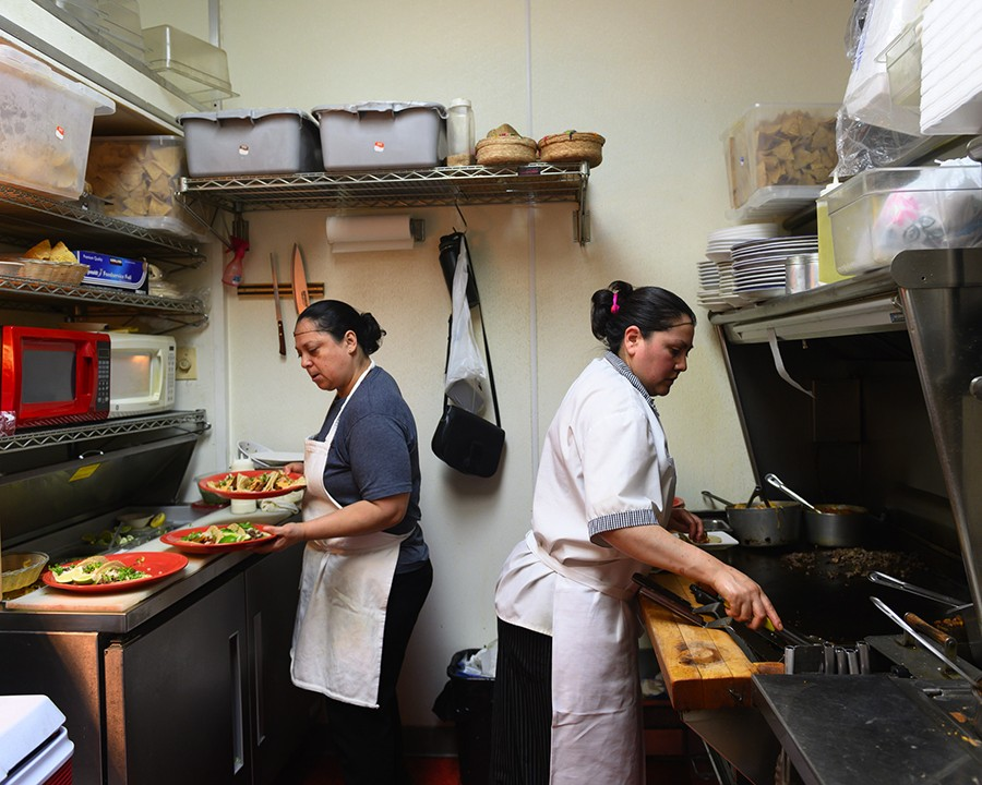 Maria Ramirez, whose husband, Benjamin, founded Buena Vista, works alongside longtime employee Ricarda, who's been with the restaurant for 13 years. - GONZALO GUZMAN