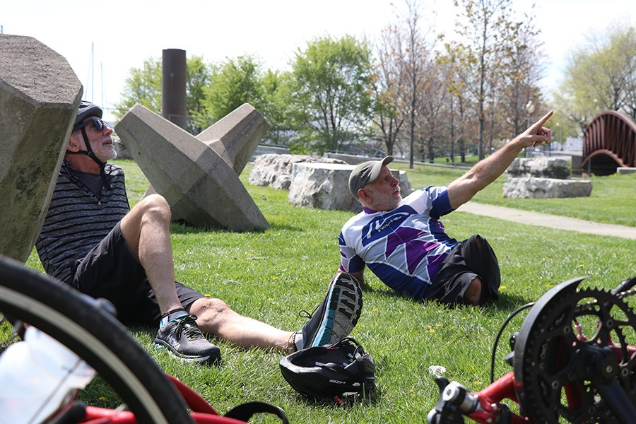 Lenzo and his brother rest during their ride. - CAROLYN CHEN