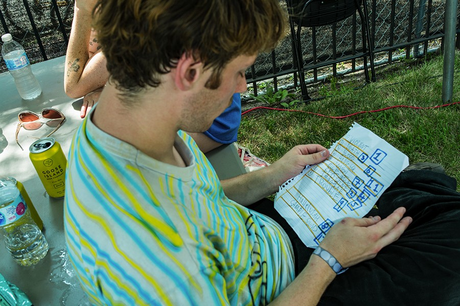 Chris Bailoni looks over Grapetooth's setlist before performing. - TIM NAGLE