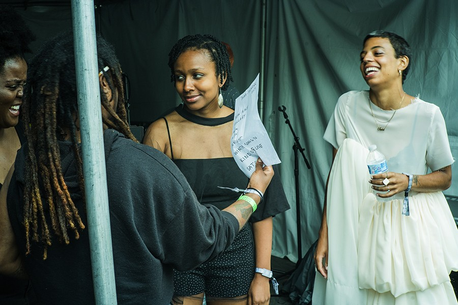 Tasha talks with her band before taking the stage. (Left to Right: Red, Akenya Seymour, Ayanna Woods, Tasha) - TIM NAGLE