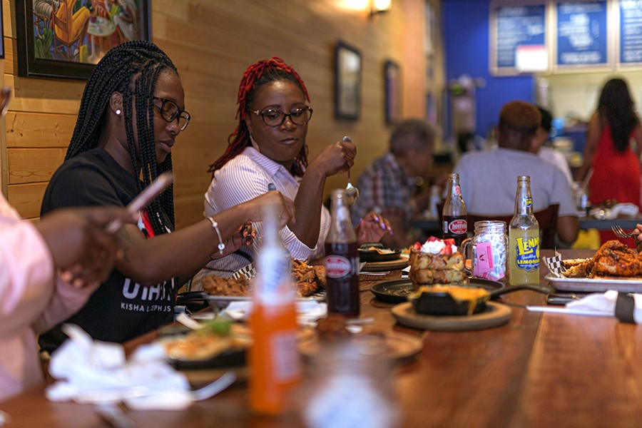 The Moore family eats a post-church brunch at Luella's Southern Kitchen. - LESLIE FREMPONG