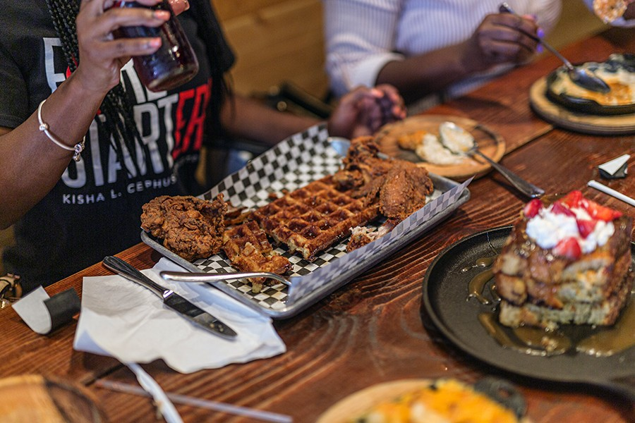 Chicken and waffles and brown sugar and bourbon French toast - LESLIE FREMPONG