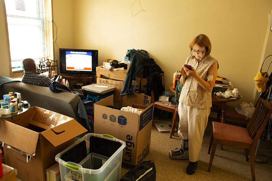 Longtime Lathrop residents Joseph Burrell and Cynthia Scott pack up their public housing apartment in preparation for a move to one of the development's rehabbed units. - JASON REBLANDO