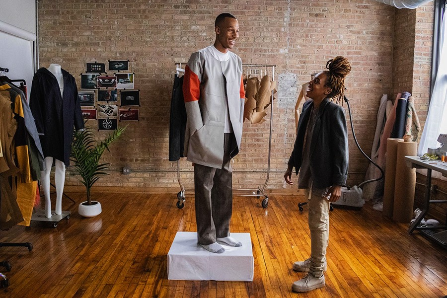 At Sheila Rashid's studio in the Marshall Lofts, she and a model wearing her designs get ready to shoot a Nissan commercial. - COURTESY SHEILA RASHID