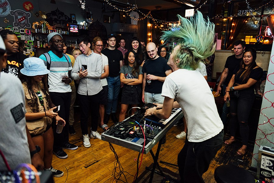 """Matt Palenske, aka Consumer., performs a """"feature"""" set during Open Beats at Cafe Mustache on Friday, September 20. - ALLISON ZIEMBA FOR CHICAGO READER"""