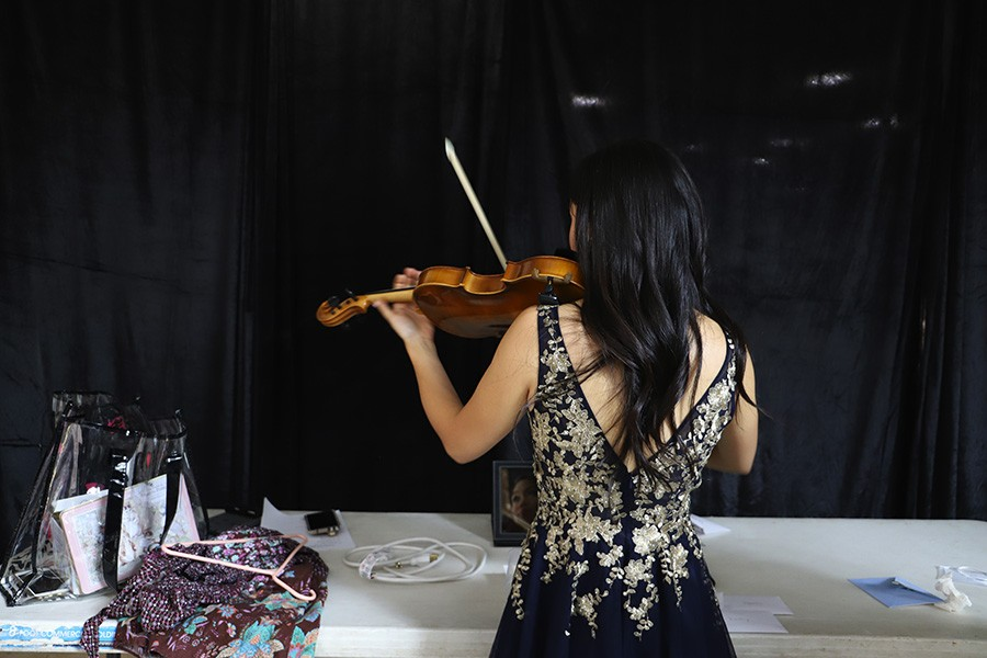 Megan Wu practices violin prior to the pageant competition. - CAROLYN CHEN