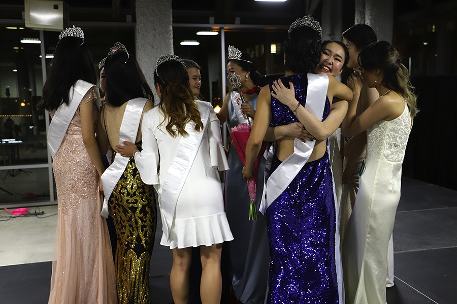 The contestants and court of Miss Chinese Chicago 2018 hug each other after the announcement of the new court. - CAROLYN CHEN