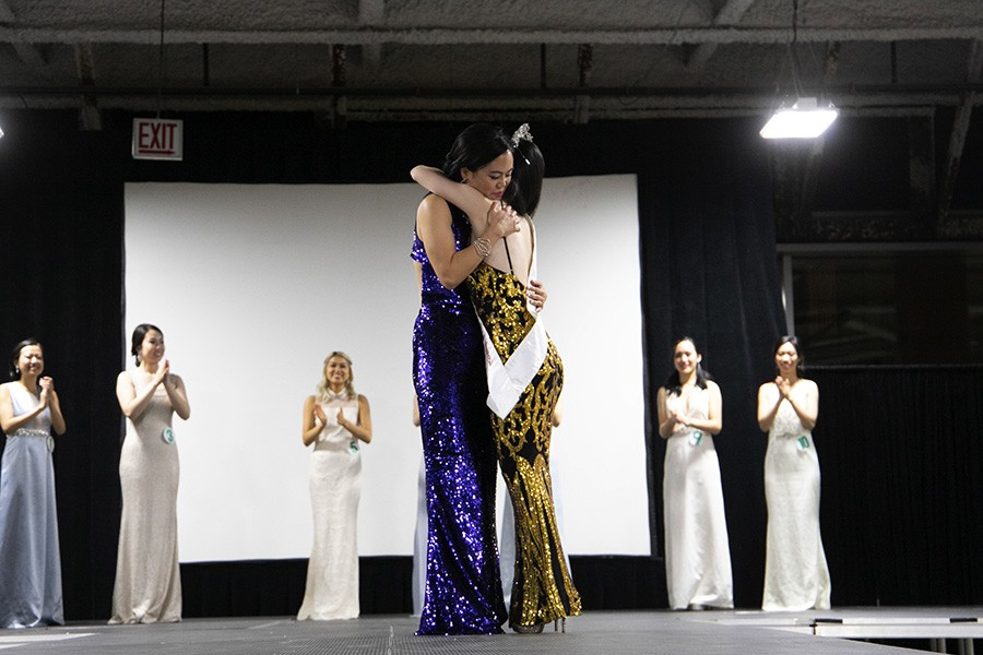 Jamie Moy, Miss Chinese Chicago 2018 first princess, and Megan Wu, Miss Chinese Chicago 2019 first princess, hug each other. - CAROLYN CHEN