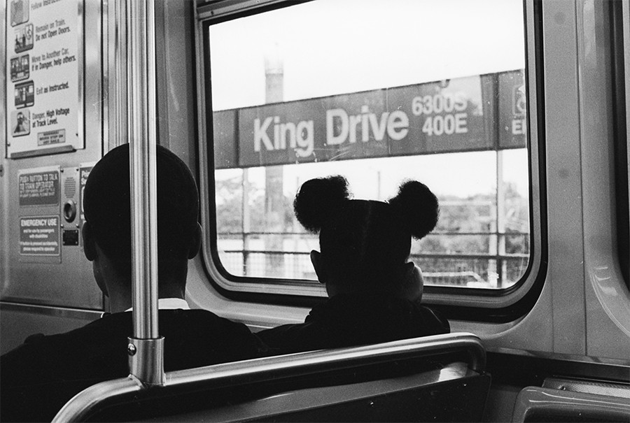 Patrons gaze out the window as the train pulls into King Drive. - W.D. FLOYD FOR CHICAGO READER
