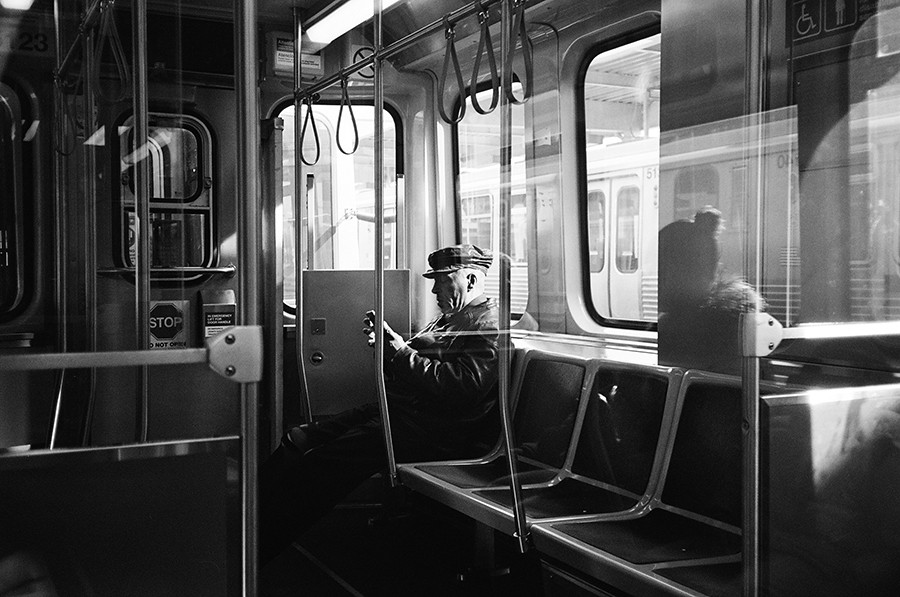 A man waits for the train to leave Cottage Grove. - W.D. FLOYD FOR CHICAGO READER