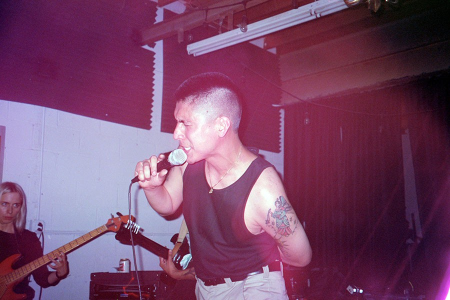 Cesar Robles fronts Bruised at the release party for the LP edition of their debut album, Rotten Codex, in summer 2019. - COURTESY CHICAGO RESEARCH