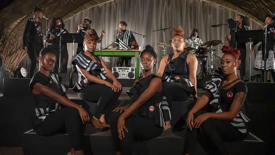 Damon Locks (back row, fourth from left) with the Black Monument Ensemble at Garfield Park Conservatory in November 2018 - DARIS JASPER