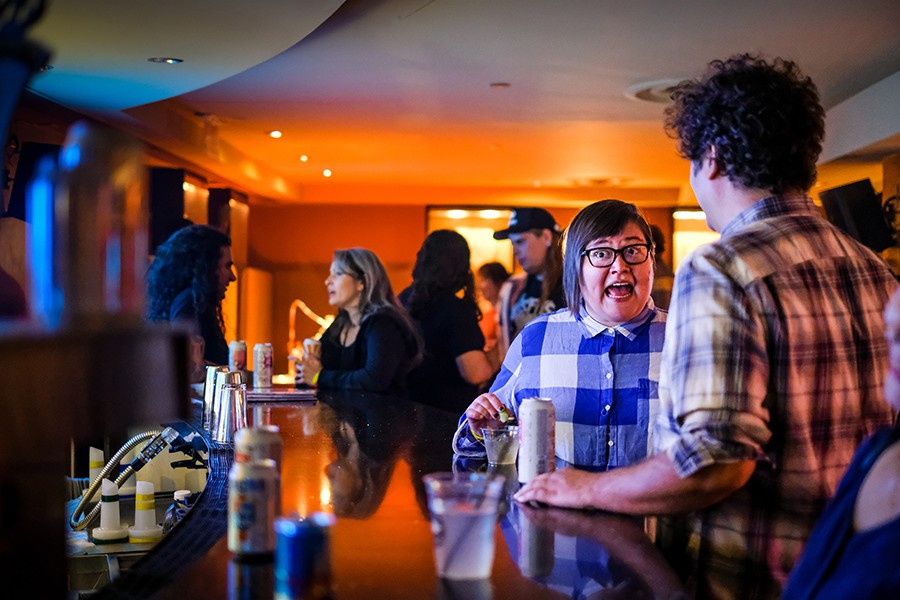 Christen Thomas at the Hard Rock Hotel bar during a 2017 Lollapalooza afterparty, where the lineup included the Black Lips, the Ponys, and the Life and Times - ALISON GREEN