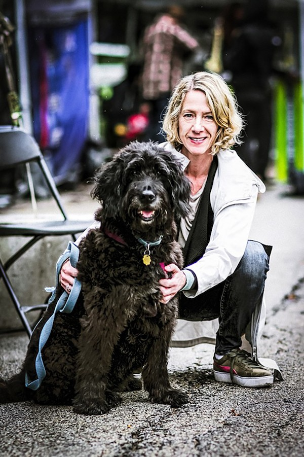 Hyde Park Jazz Festival executive and artistic director Kate Dumbleton at last year's event with her dog Blue - MICHAEL JACKSON FOR CHICAGO READER