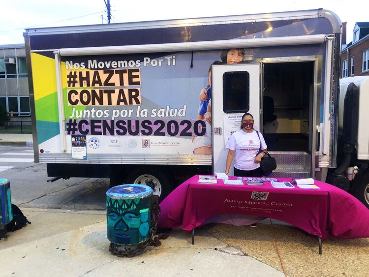 """Pilar Rodriguez approached community members about the census at """"El Zocalo"""" plaza in Pilsen. She noticed hesitancy from some Latinx community members on this year's census. - ALEXANDRA ARRIAGA"""