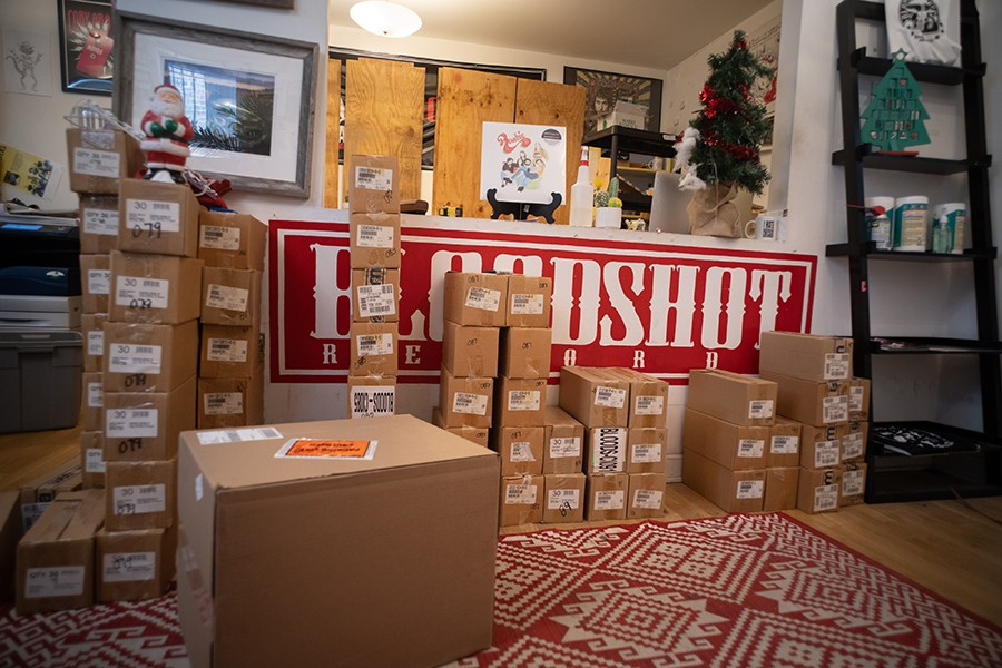 Inventory in boxes at Bloodshot's headquarters at 3039 W. Irving Park - MATTHEW GILSON FOR CHICAGO READER