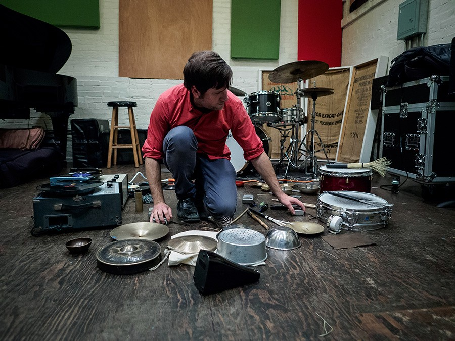 For most of the past six years, Tim Daisy has focused on exploring solo setups like this one, which includes transistor radios and portable turntables. - PETER GANNUSHKIN
