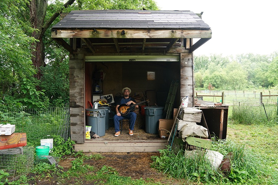 Leise in a shack on his property - ELIZABETH SISSON