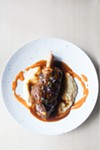 Lamb shank and polenta with citrusy sauce spiked with sansho pepper