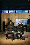 WLPN founder Ed Marszewski and director Logan Bay outside the station's studio at the Co-Prosperity Sphere