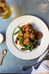 The sweetbreads are served with capers, potatoes, and cipollini onions, all covered in a lemony brown butter sauce.