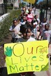 Students from Parkside Community Academy march against violence in South Shore in June 2016. Trump's proposed budget cuts would target health and safety initiatives for low-income youth.