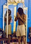 Martavier Lover, 18, checks himself out in the mirror before wrapping his hands. Other boxers will also use the mirror to practice their rope drills or to shadow box, watching themselves throw jabs.