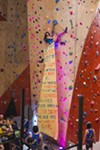 """Abhijeet Rane reveals their banner while climbing. """"It doesn't matter like what kind of like gender you are it's just like [climbing] is fun and all the queens did it and they kicked ass,"""" says Rane."""