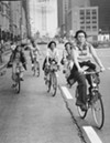 Helmetless cyclists on Michigan Avenue in 1976
