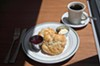 Biscuit, jam, and coffee