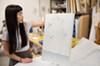 Mika Horibuchi showing one of her earlier paintings that plays with trompe l'oeil, or ideas of optical illusion.