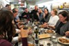 Guests enjoy Chef David Campignotto's cassoulet at the fifth annual cassoulet throwdown, held in Publican Quality Meats' kitchen.