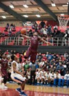 Jacobs dunks at the Proviso West Annual Holiday Tournament in December.