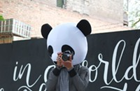 Local musician spreads his cheer in a panda mask