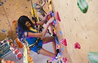 Drag queens find unlikely spot to perform—on a 50-foot climbing wall