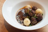 Goat meatballs in black mole - ANTHONY SOAVE