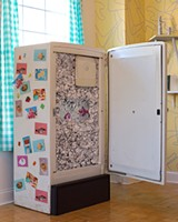 New York duo Lazy Mom's video installation is on display inside of an old-fashioned refrigerator. - SUNSHINE TUCKER