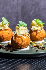 "Quartet of arancini filled with smooth mortadella mousse, carefully draped with julienned golden beet and stabilized on a base of stiff mozzarella ""sauce."" - JEFFREY MARINI"