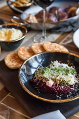 Smoked beet tartare studded with crunchy bits of broken sunflower seed and topped with a snowcap of sharp goat Gouda and dollops of cumin-spiked yogurt - JAMIE RAMSAY