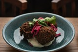 Falafel atop labneh compounded with the mango spread amba - MATTHEW GILSON