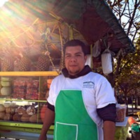 "The People Issue, 2011 Victor Mejia sells fresh fruit gazpacho at a Rogers Park intersection four or five months a year. The rest of the time he lives in Michoacan, Mexico, with his family. ""Sometimes the police give me a hard time. I keep moving, corner by corner."" Saverio Truglia"