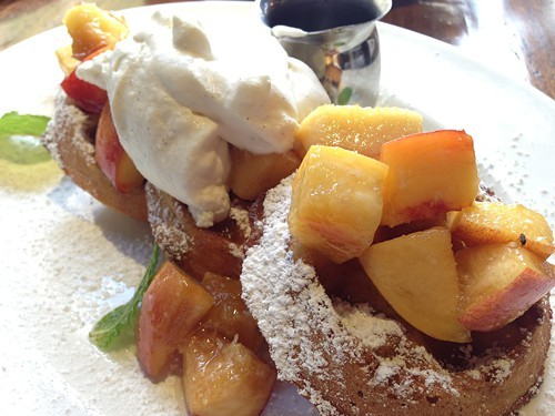 Waffles with peaches and cream