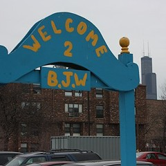 Welcoming sign at the Barbara Jean Wright apartments, a Near West Side affordable housing complex that's been divided up by ward redistricting.