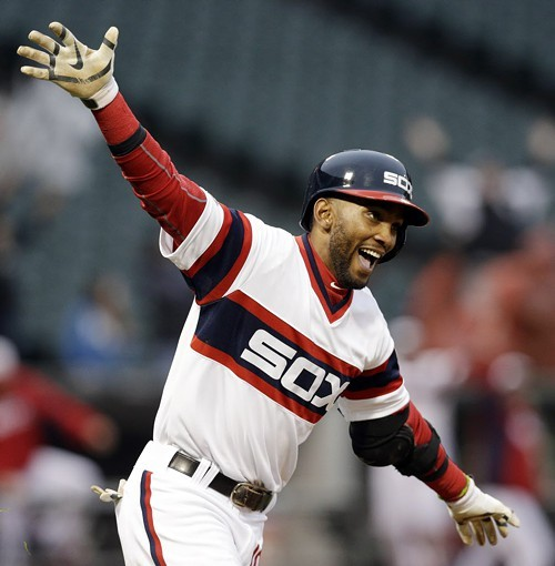 White Sos shortstop Alexei Ramirez flies around the bases after hitting the game-winning homer yesterday at the Cell