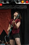 Wild Flag's Carrie Brownstein looks to the sky and tells the rain to stop. It did.