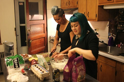 Yana Gilbuena (left) and Julia Pham prepping in Phams kitchen.