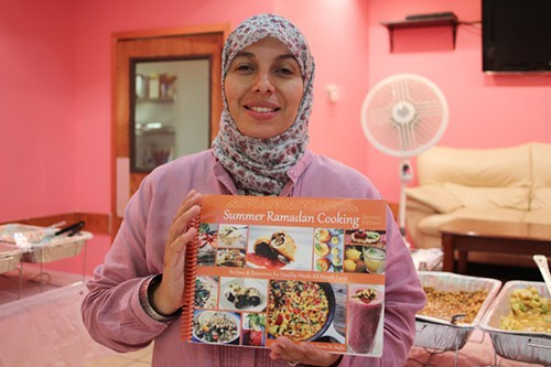 Yvonne Maffei with her book Summer Ramadan Cooking.