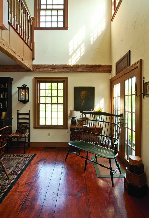 12-over-12 windows, hand-stained wide-plank flooring, and 18th-century barn beams are featured throughout the home. - DEBORAH DEGRAFFENREID
