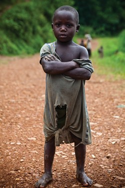 A CHILD ALONG THE ROAD AT ISHUNGA. - TIM FRECCIA