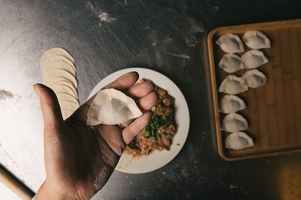 A freshly pressed dumpling before it's sent to the steamer. - THOMAS SMITH